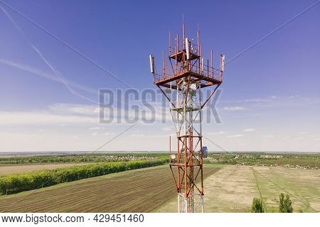 Telephone Tower With 5g Base Station Antenna On Cell Site. Aerial View Of Telecommunication Mast