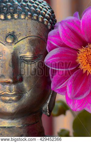Buddha Face And Flower. Spiritual Meditation And Zen Buddhism Nature Image. Close Up Of A Gold Seren