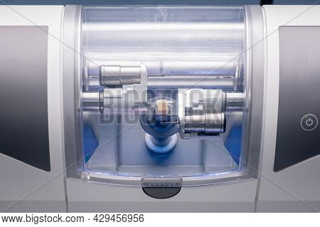 Cad Cam Dental Computer-aided Machine. Digital Modern Dental Laboratory For Prosthesis And Crowns Mi