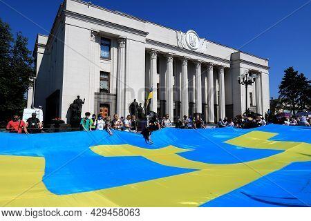 A Huge Crimean Tatar Flag Was Unfurled Near The Verkhovna Rada Of Ukraine. Crimean Tatars Hold A Lar
