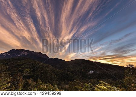 Sunrise At The Mount Kinabalu, Borneo, Sabah, Malaysia. The Sun Comes Up Behind The Highest Mountain