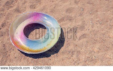 Swimming Ring. Children Baby Swimming Lap. Inflatable Swim Ring On Sand Beach