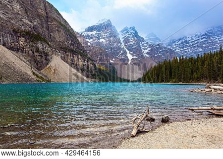 Picturesque and magnificent mountain lake Moraine. Canadian Rockies. Banff Park. The glacial lake is fed by glacier melt water and is located in the Valley of the Ten Peaks