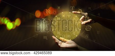 Human Predicts The Future. Astrology Zodiac Sign Horoscope Wheel Of Fortune Hologram With Mandala In