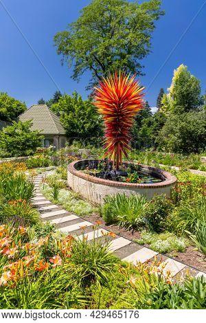 DENVER, COLORADO, July 22, 2021 - Fiber glass artistry of sculptor on display among the Flower garden at Denver Botanic Gardens .