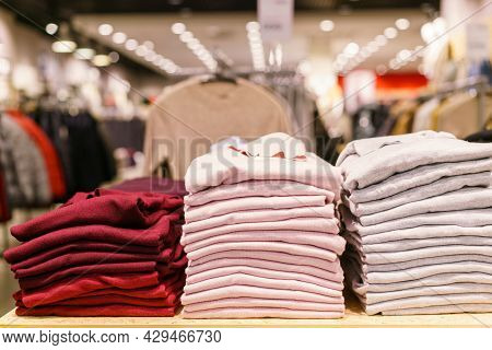 Stack Of Colorful T-shirts. Layers Of Multi-colored Fabric. Stack Of Colorful Folded Clothes, Multic