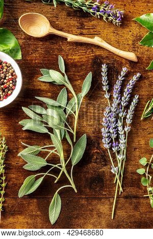 Sage, Lavender And Other French Herbs, Shot From The Top On A Dark Rustic Wooden Table