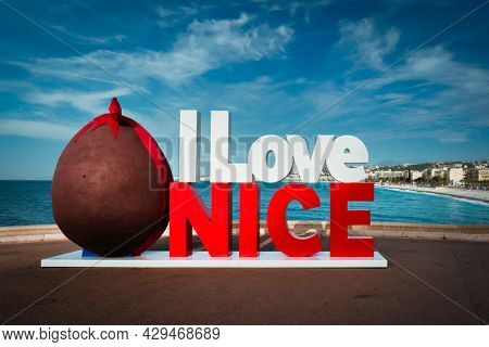 I love Nice in Easter style with chocloate egg with Nice town and beach in background. Nice, France