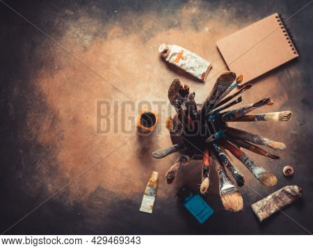Paint brush and art painter tool on abstract background texture. Paintbrush for painting as artistic paint still life. Abstract art concept