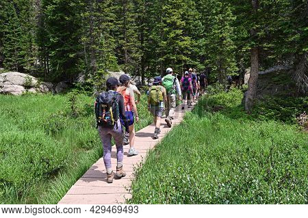 Rocky Mountain National Park, Colorado - July 26, 2021 - Visitors Hike On Crowded Emerald Lake Trail