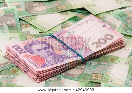 Heap of ukrainian hryvna, on moneys background
