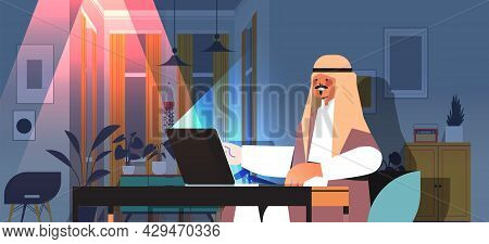Overworked Arab Businessman Freelancer Looking At Laptop Screen Arabic Man Sitting At Workplace In D