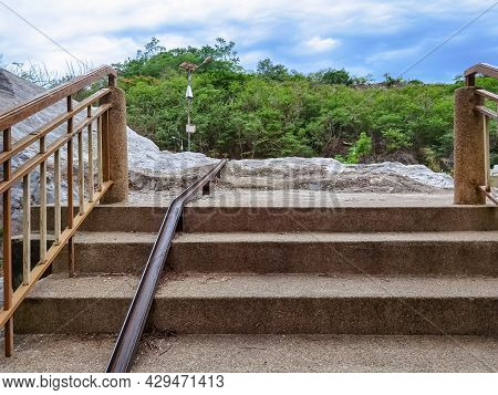 Stair-safe Bike Ramp Along Stairs. Comfortable And Safe Lanes For Bicycles On Stairs. Old And Rusted