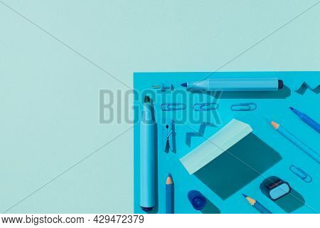 Top View Photo Of Ordered School Supplies Blue Stationery Markers Pencils Sticky Note Paper Clips An