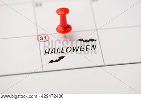 Closeup Photo Of Mark On Calendar At Thirty-first Inscription Halloween And Drawing Bats With Red Pu