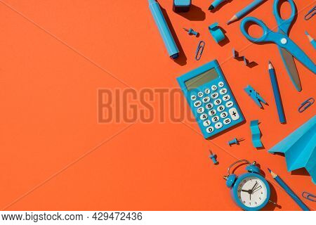 Top View Photo Of Blue School Accessories Stationery Calculator Markers Pencils Clips Pushpins Sciss