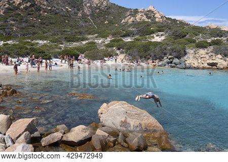 Island Of Spargi Sardinia, Italy - July 28, 2021: Tourists On The Island Of Spargi In Sardinia. Spar