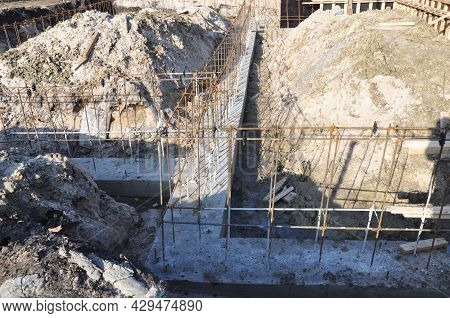 A Close-up Of A Concrete Footing, Concrete House Foundation Construction With Rebars, Reinforcing St