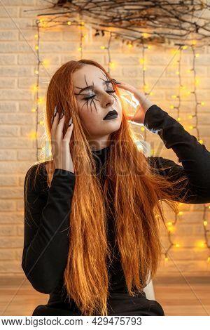 Halloween Witch Woman Portrait, Garland On Background.