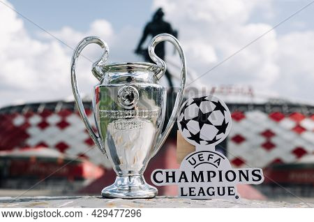 June 14, 2021 Moscow, Russia, Uefa Champions League Cup And Emblem In Front Of A Modern Stadium.