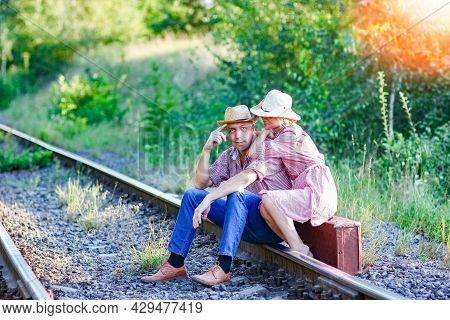 A Happy Couple Cowboys With Suitcase A