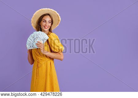 Dreamy Wealthy Lady Hold Cash Fan Look Empty Space Wear Yellow Dress And Straw Hat Isolated Violet C