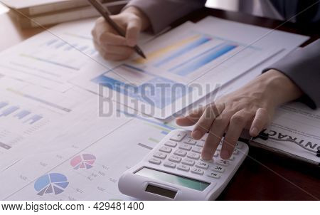 Businesswoman Calculates Income Reports, Taxes, Losses, Finance. Business And Accounting Concept.