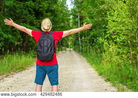 Caucasian Male Tourist In Forest With His Arms Wide Open. Copy Space.man Backpacker Arms Outstretche
