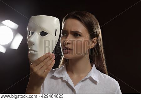Professional Actress With Mask On Stage In Theatre