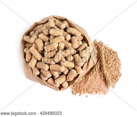 Granulated Wheat Bran In Bag And Spikelets On White Background, Top View
