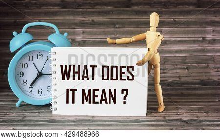 Business And Finance Concept. On A Wooden Background There Is An Alarm Clock, A Wooden Doll And A No