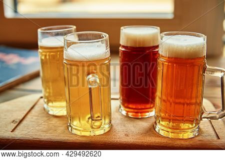Beer Set In The Pub. Different Kind Of Beer In Glasses On Table