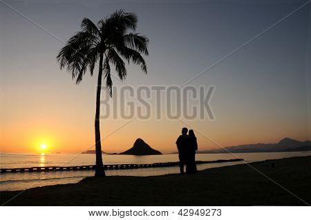Couple Enjoying a Chinaman's Hat Sunrise