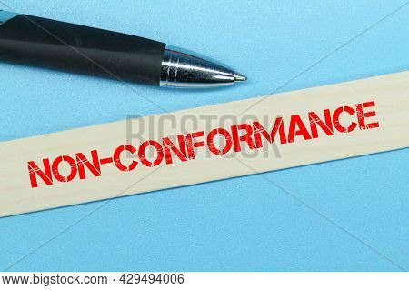 Pen, A Stick Of Colored Ice Cream With The Word Non-conformance