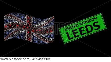 Glare Mesh Polygonal Waving United Kingdom Flag With Light Spots, And Scratched United Kingdom Leeds