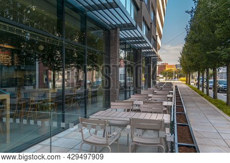 Empty Street Cafe. Empty Tables And Chairs Of A Street Cafe. No Visitors.