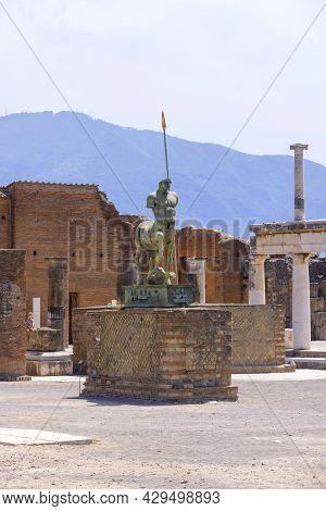 Pompeii, Naples, Italy - June 26, 2021: Statue By Polish Sculptor Igor Mitoraj On Forum Of Riuns Of