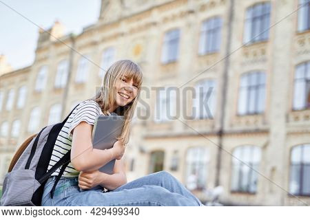 Cute Blonde Female University Student Or Education Concept. Attractive Cheerful Young Female College