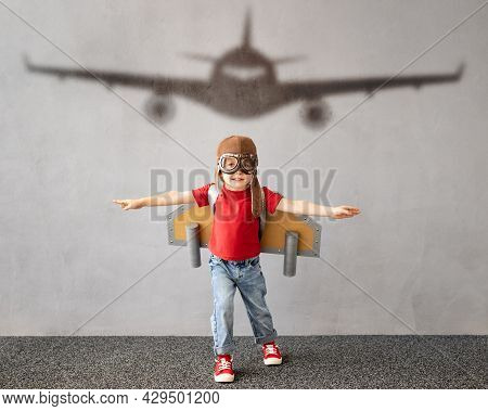 Child Pretend To Be Pilot. Kid Having Fun At Home. Summer Vacation And Travel Concept