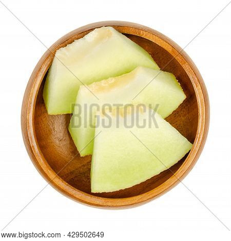 Galia Melon Slices, In A Wooden Bowl. Triangular And Ready-to-eat Pieces Of A Freshly Cut And Ripe F