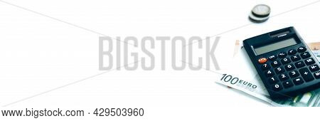 Calculator, Paper Money And A Stack Of Coins Isolated On White Background. Family Budget Concept And