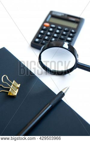 Calculator, Magnifier, Pen, Notepad And Golden Clip Isolated On White Background. Family Budget Conc