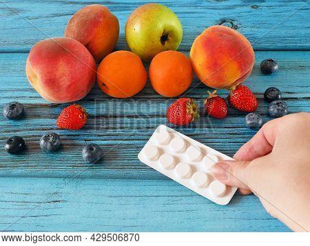 Fresh Natural Fruits Vs Pills. Natural Vitamin In Fruits Vs Synthetic Vitamin In Pills. Choice Betwe