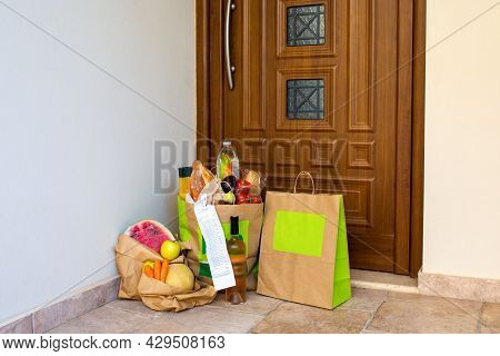 A Grocery Bag Under The Door Of The House.food Delivery To The Door In Craft Bags.home Delivery Of O