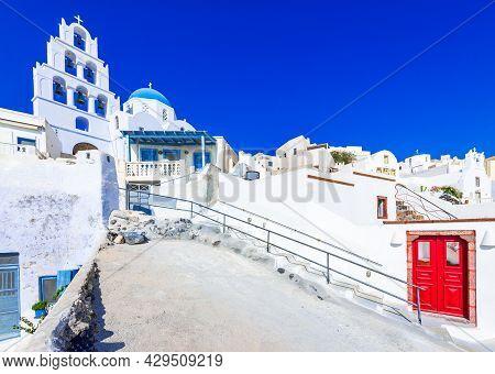 Pyrgos, Santorini, Greece. Whitewashed Church On Famous Island Of Santorini, Pyrgos Small Cobbled St
