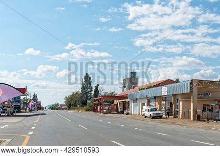 Reddersburg, South Africa - April 23, 2021: A Street Scene, With Businesses, People And Vehicles, In