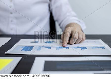 Close-up Pressing A White Calculator, A Female Auditor Using A Calculator To Verify The Accuracy Of
