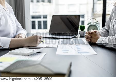 Two Businessmen Are Working Together In Business Consultation, And They Are Planning Their Growth An
