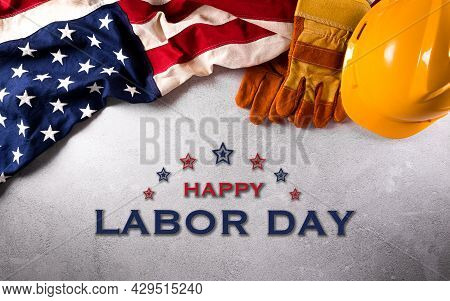 Happy Labor Day Concept. American Flag With Different Construction Tools On Dark Stone Background.