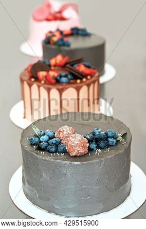 Festively Decorated Cakes On Table. Confectionery For Holiday